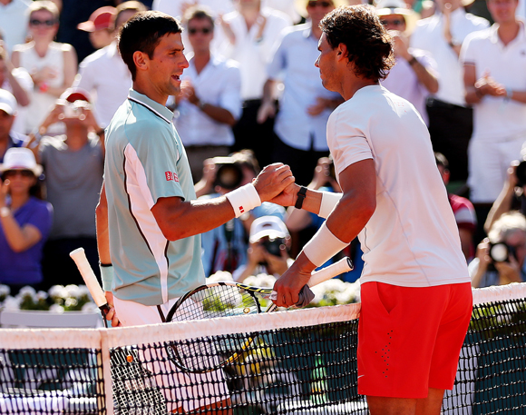 Rafael Nadal of Spain shakes hands at the net with Novak Djokovic of Serbia after their semi-final