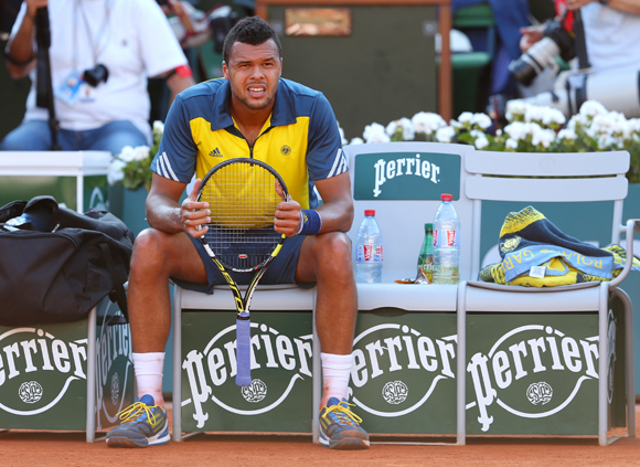 Jo-Wilfried Tsonga of France looks on as he takes a break during the semi-final against David Ferrer of Spain