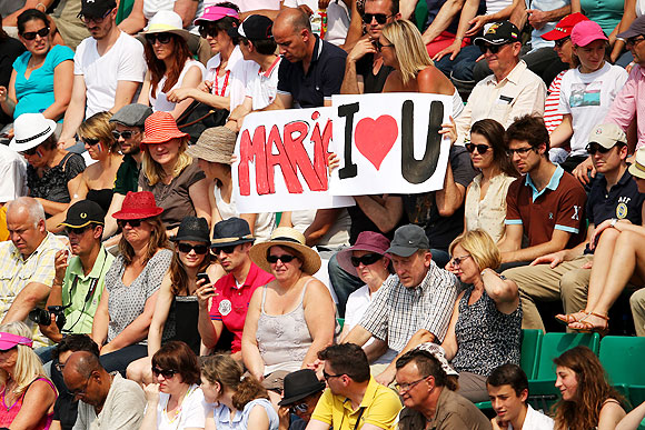 Tennis fans hold a banner in support of Maria Sharapova during the French Open final