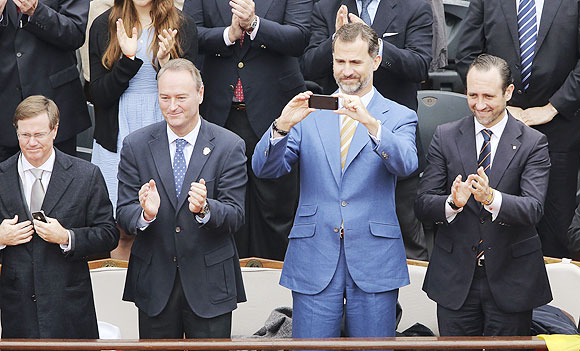 Spain's Crown Prince Felipe (2nd from right) takes a photograph during the men's singles final match between Rafael Nadal of Spain and compatriot David Ferrer on Sunday