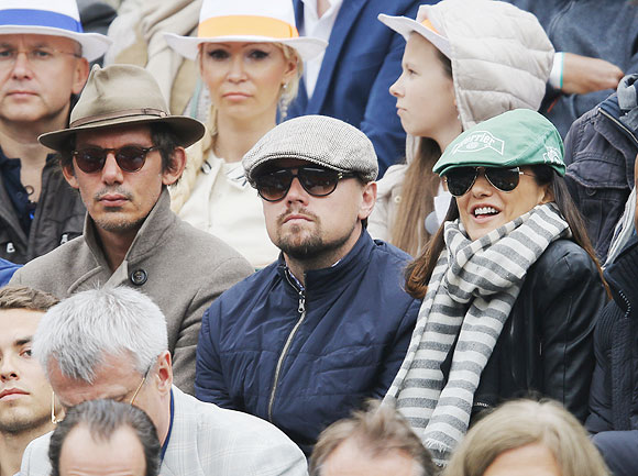 US actor Leonardo DiCaprio (centre) watches the men's singles final match between Rafael Nadal of Spain and compatriot David Ferrer at the French Open on Sunday