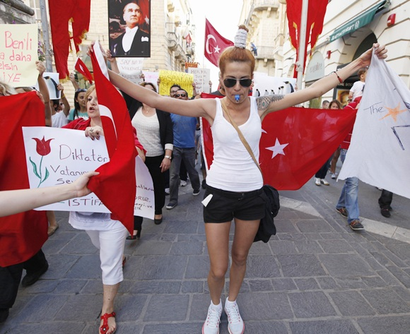 Members of the Turkish community living in Malta take part in a peaceful protest in solidarity with their compatriots in Turkey