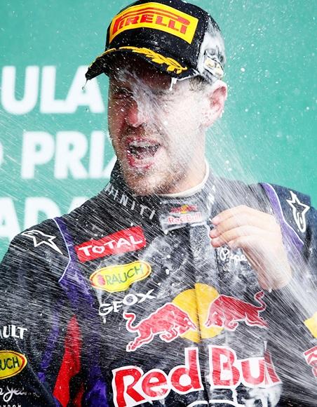 Sebastian Vettel of Red Bull celebrates on the podium after winning the Canadian Formula One Grand Prix