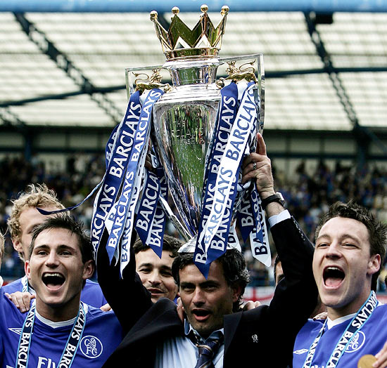 (Left to right): Frank Lampard, Jose Mourinho and John Terry with the English Premier League trophy at Stamford Bridge in London, on May 7, 2005.