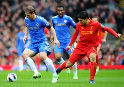 Suarez admits 'bout of temper' caused 'biting' incident