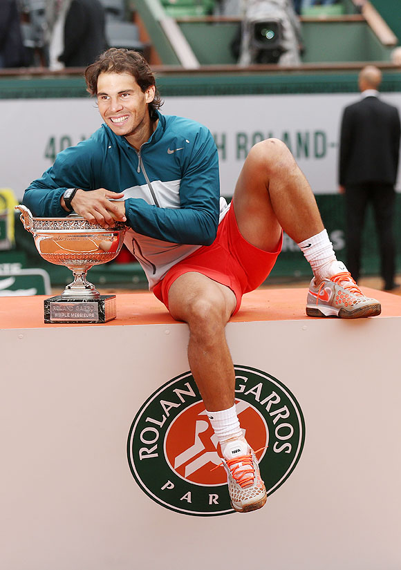 Rafael Nadal with the Coupe des Mousquetaires trophy after winning the French Open