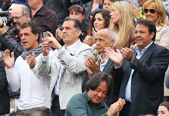 Rafael Nadal's uncle Miguel Nadal (left), father Sebastian Nadal (right), girlfriend Xisca Perello (centre top), sister Isabel Nadal (2nd form right top) and mother Ana Maria Parera (right top) during the French Open men's final on Sunday