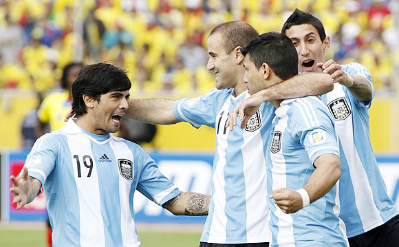 Argentina's Sergio Aguero (2nd from right) celebrates with teammates Ever Banega (left), Rodrigo Palacio and Angel Di Maria celebrate (right) after scoring against Ecuador on Tuesday