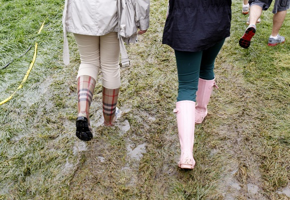 Spectators walk on a flooded pathway along a fairway duringUS   Open golf championship