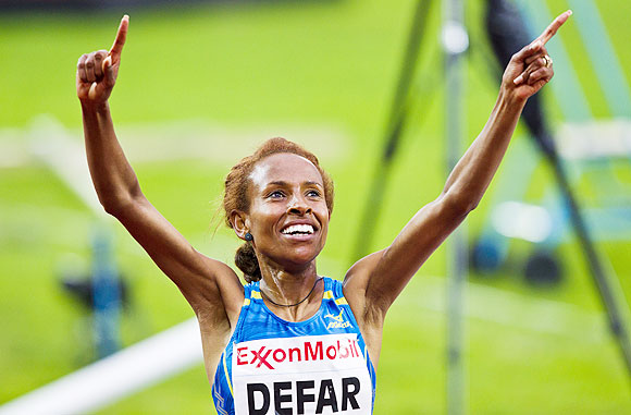 Meseret Defar of Ethiopia celebrates after winning the women's 5000m during the IAAF Diamond League athletics competition at the Bislett Stadium in Oslo on Thursday