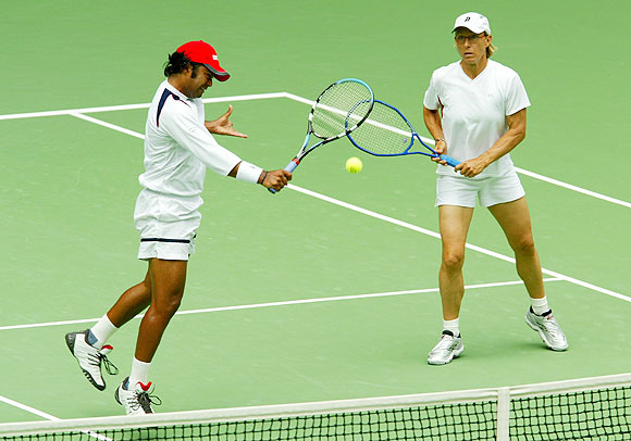 Martina Navratilova of the U.S. and Leander Paes of India in action