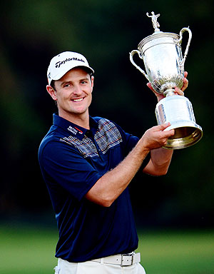 Justin Rose of England celebrates with the U.S. Open trophy after winning the 113th U.S. Open at Merion Golf Club in Ardmore, Pennsylvania, on Sunday