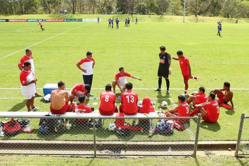 Tahiti players listen to assistant coach Ludovic Graugnard