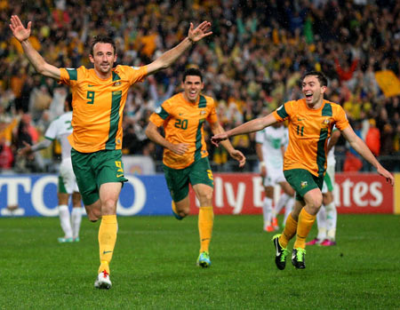 Joshua Kennedy celebrates after scoring the winning goal in the FIFA 2014 World Cup Asian Qualifier match against Iraq