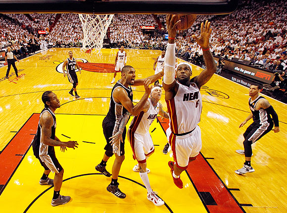 LeBron James of the Miami Heat goes up for a shot against the San Antonio Spurs