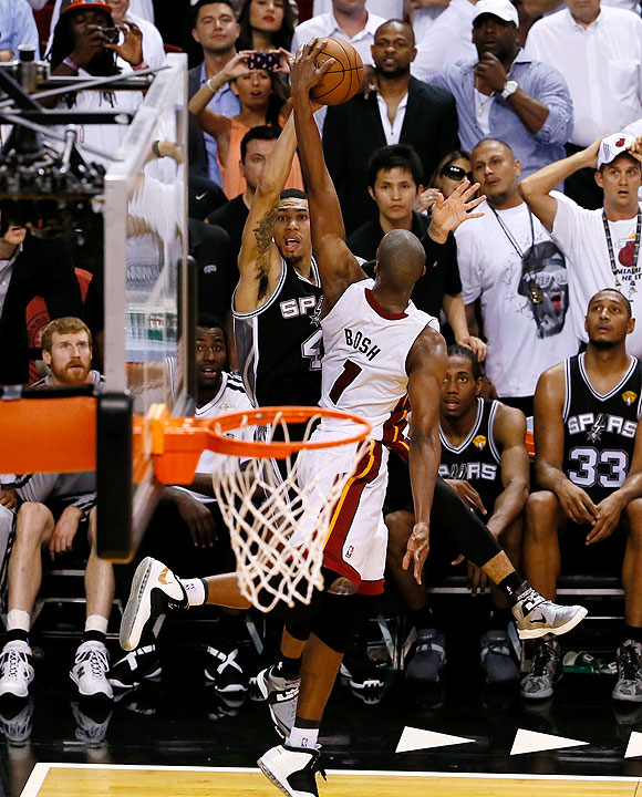 Chris Bosh of the Miami Heat blocks the last second three-point attempt by Danny Green of the San Antonio Spurs