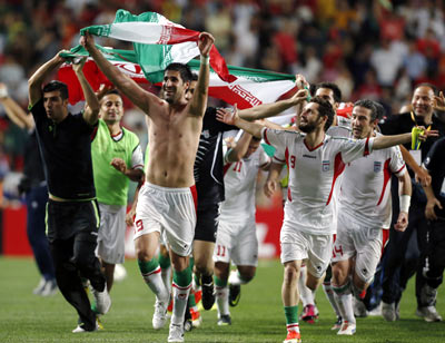 Iran's football players celebrate victory