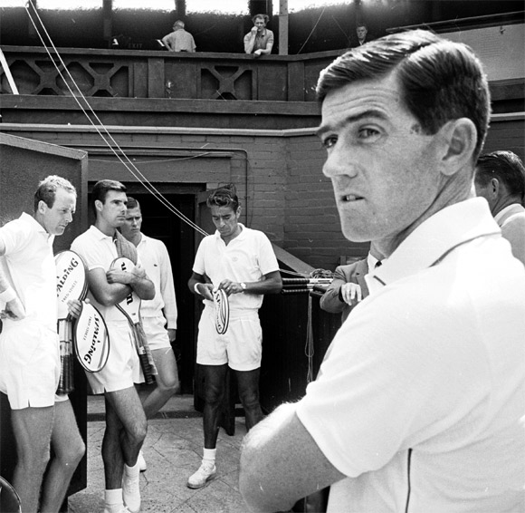 Professional tennis stars line up for a practice session at Wimbledon in 1967. Ken Rosewall stands on the right