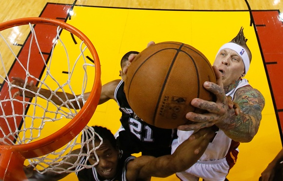 Chris Andersen (11) of the Miami Heat goes up for the ball   against Kawhi Leonard (2) of the San Antonio Spurs