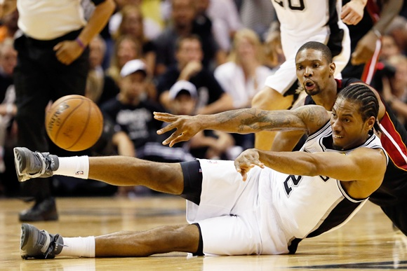Kawhi Leonard (2) of the San Antonio Spurs and Chris Bosh (1) of the Miami Heat go after a loose ball