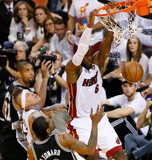 LeBron James (6) of the Miami Heat dunks the ball