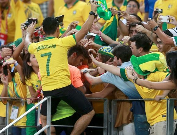 Neymar of Brazil celebrates with fans