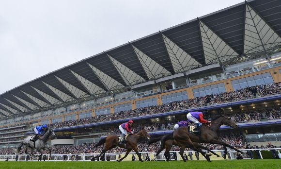 Estimate jockeyed by Ryan Moore (R) wins The Gold Cup for its owner Britain's Quee