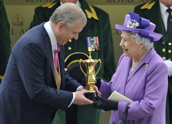Britain's Queen Elizabeth smiles as she is presented with The Gold Cup by her son Prince Andrew after her horse Estimate won the feature race during ladies day at the Royal Ascot horse racing festival at Ascot