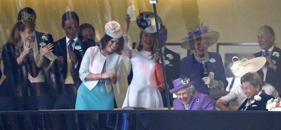 Britain's Queen Elizabeth reacts with members of her family and her racing team as she watches her horse Estimate win The Gold Cup during ladies day at the Royal Ascot horse racing festival at Ascot