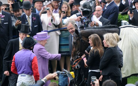 Queen Elizabeth II congratulates her horse Estimate following Gold Cup win on Ladies Day on Day 3 of Royal Ascot at Ascot Racecourse on June 20, 2013 in Ascot