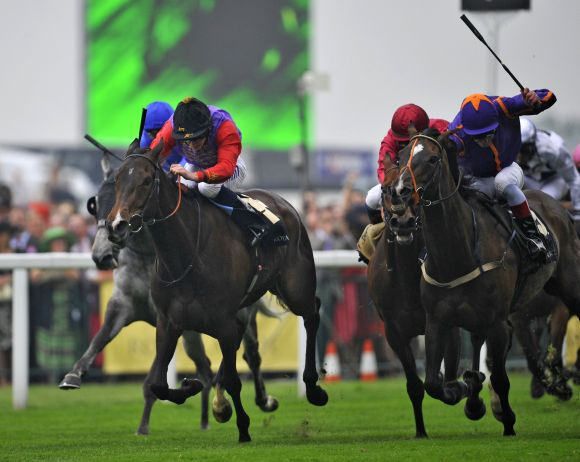 Estimate jockeyed by Ryan Moore (L) wins The Gold Cup for its owner Britain's Queen Elizabeth during ladies day at the Royal Ascot horse racing festival at Ascot