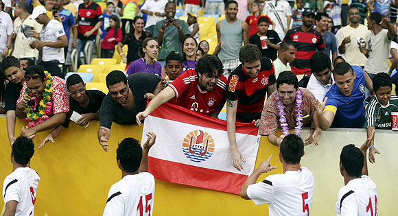 Tahiti's players greet their fans before their Confederations Cup Group B match against Spain at the Estadio Maracana in Rio de Janeiro on Thursday