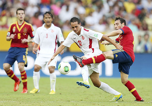Tahiti's Edson Lemaire (2nd from right) fights for the ball with Spain's Santi Cazorla (right) during their Confederations Cup Group B match at the Estadio Maracana in Rio de Janeiro on Thursday