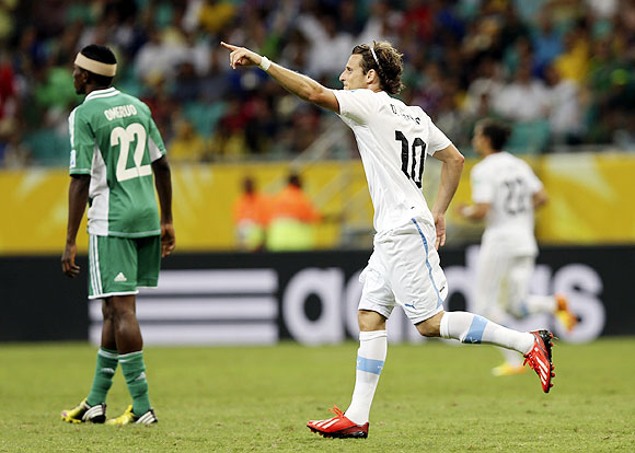 Uruguay's Diego Forlan celebrates after scoring against Nigeria during their Confederations Cup Group B match at the Arena Fonte Nova in Salvador on Thursday