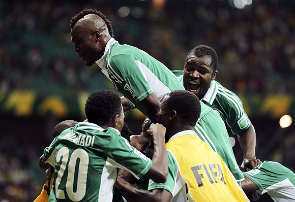 Nigeria's players celebrate after John Obi Mikel scored the equaliser against Uruguay during their Confederations Cup Group B match at the Arena Fonte Nova in Salvador on Thursday