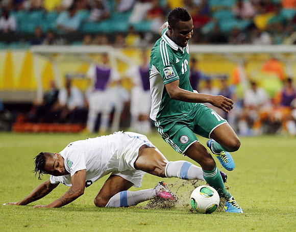 Uruguay's Alvaro Pereira (left) fights for the ball with Nigeria's John Obi Mikel during their Confederations Cup Group B match at the Arena Fonte Nova in Salvador on Thursday