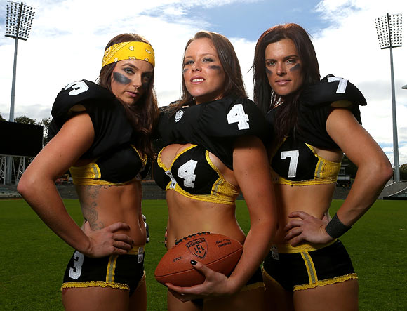 Leah Turnbull, Elise Chapman and Tammie West of the Western Australian Angels pose during a Legends Football League