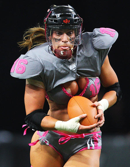 Saige Steinmetz of the Eastern Conference NSW Blues runs the ball during game two of the All-Star Lingerie Football League