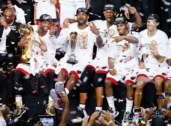 LeBron James (centre) celebrates with Miami Heat teammates after defeating the San Antonio Spurs 95-88 to win Game Seven of the 2013 NBA Finals at AmericanAirlines Arena on Thursday