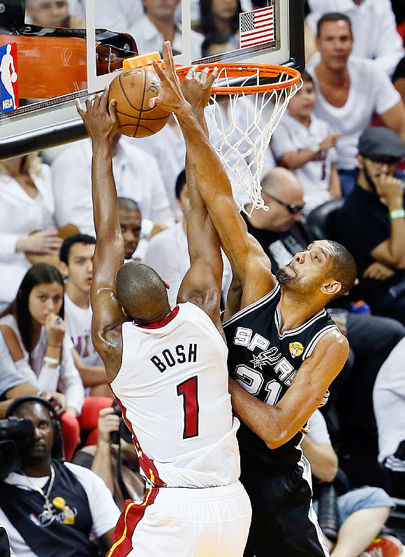 Chris Bosh #1 of the Miami Heat goes up for a dunk over Tim Duncan #21 of the San Antonio Spurs in the first half during Game Seven of the 2013 NBA Finals on Thursday