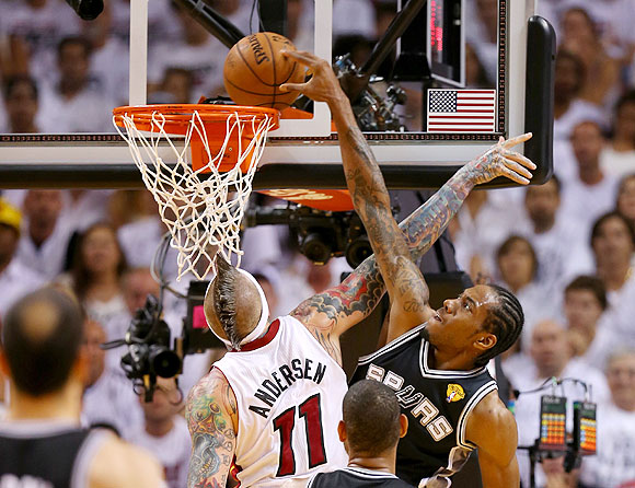 Kawhi Leonard #2 of the San Antonio Spurs goes up for a dunk over Chris Andersen #11 of the Miami Heat in the second quarter during Game Seven of the 2013 NBA Finals on Thursday