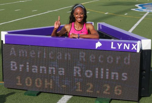 Brianna Rollins poses with the sign board after setting a new American Record of 12.26 seconds in the Women's 100 Meter Hurdles final on day three of the 2013 USA Outdoor Track & Field Championships at Drake Stadium