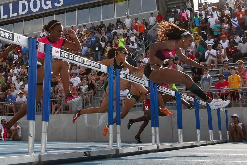 Brianna Rollins (R) clears a hurrdle en route to winning the Women's 100 Meter Hurdles final on day three of the 2013 USA Outdoor Track & Field Championships at Drake Stadium