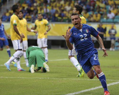 Italy's Emanuele Giaccherini celebrates after scoring a goal during their Confederations Cup Group A soccer match against Brazil at the Arena Fonte Nova