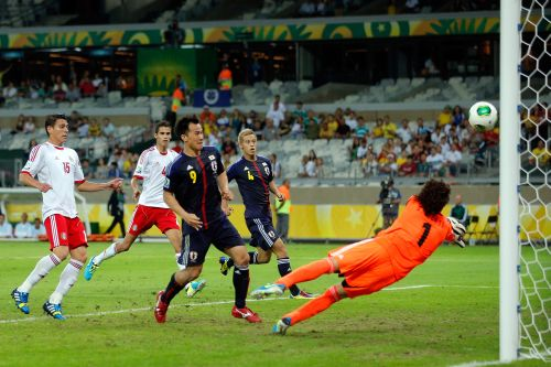 Shinji Okazaki of Japan scores a goal in the 86th minute past Guillermo Ochoa of Mexico during the FIFA Confederations Cup Brazil 2013 Group A match between Japan and Mexico