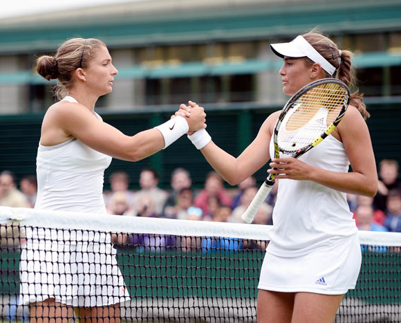 Sara Errani (left) shakes hands with Monica Puig after the match