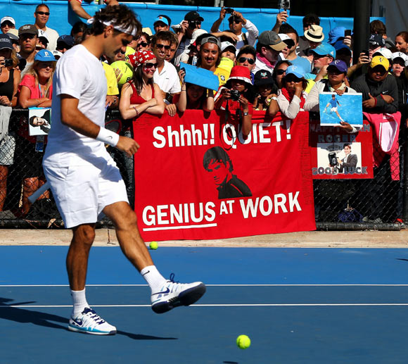 Fans watch Roger Federer during a practice session at the 2013 Australian Open