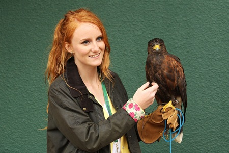 Imogen Davis (L) poses with Rufus the Hawk