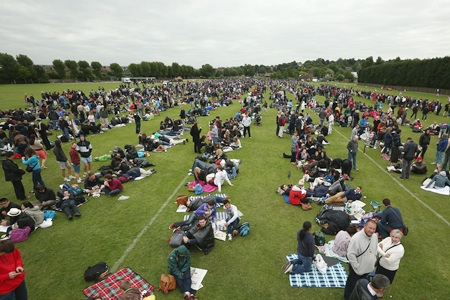 Fans queue for entry into the grounds on day one of the Wimbledon Lawn Tennis Championships at the All England Lawn Tennis and Croquet Club