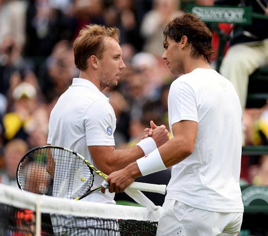Steve Darcis (left) speaks to Rafael Nadal after the match